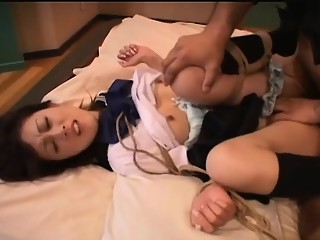 Asian schoolgirl getting fucked in a bdsm session