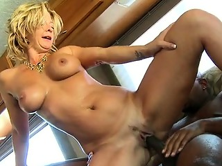 Milf loves having her snatch drilled by a black shlong
