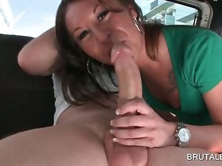 Redhead sucks huge cock in the bus