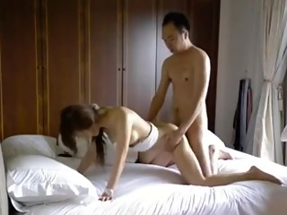 Asian guy tease and fucks his sexy Asian slut.