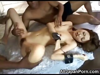 Japanese girls takes on two black cocks and gives them a