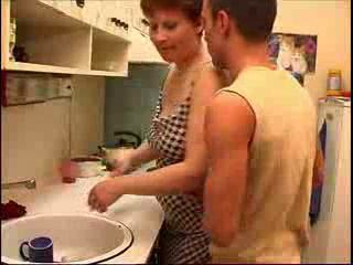 mother washes dishes
