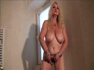 Granny Dana (66) strips and masturbates