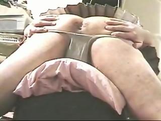 Upskirt butt-spreading in pleated miniskirt