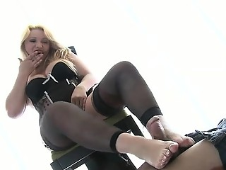 Hot chick smothers a dude's face with feet and gives footjob