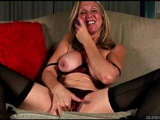Saucy old spunker in stockings loves to fuck her juicy pussy