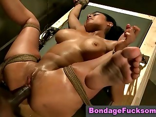 Tight ass slut gets roped up to receive some black slave