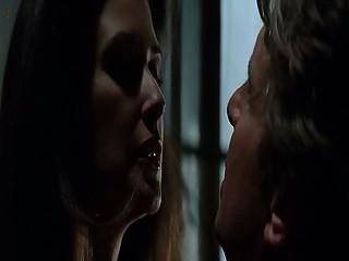 Demi Moore straddling Michael Douglas as she seduces him