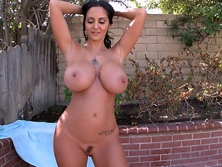Ava Addams showing her oiled tits and pussy