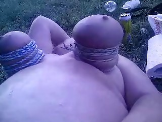 This chubby woman has her tits tied up extreme and gets