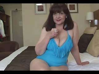 Attractive big tits mature lady in tight swimsuit playing