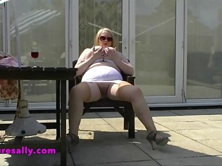 Granny flashes her big tits for her neighbour to see