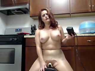 Redhead has intense squirting orgasm on sybian
