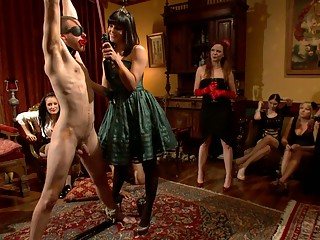 A group of women dominating slaveboy